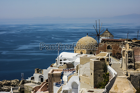 oia greece greek windmill tan dome