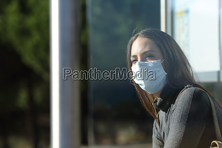woman wearing a mask waiting in