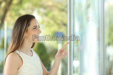 happy woman checking time table at