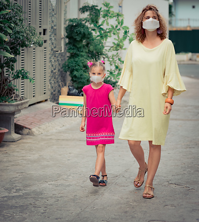 woman and daughter wearing facial disposable