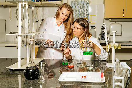 two female laboratory technicians researching medical