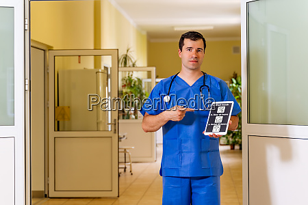 male doctor standing in hospital with