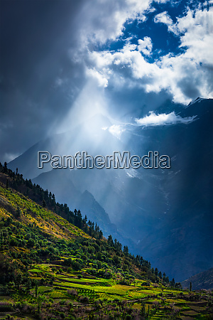 sun rays through clouds in himalayan