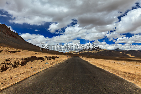 road on plains in himalayas with
