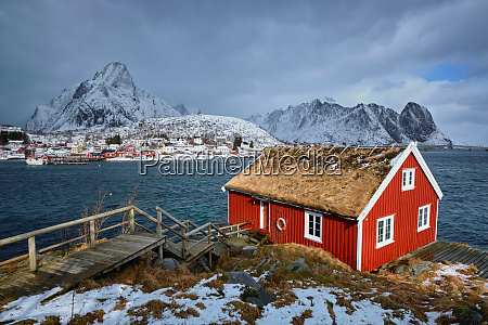 traditional red rorbu house in reine