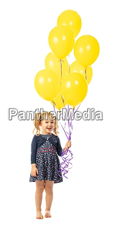 menina caucasiana com baloes amarelos