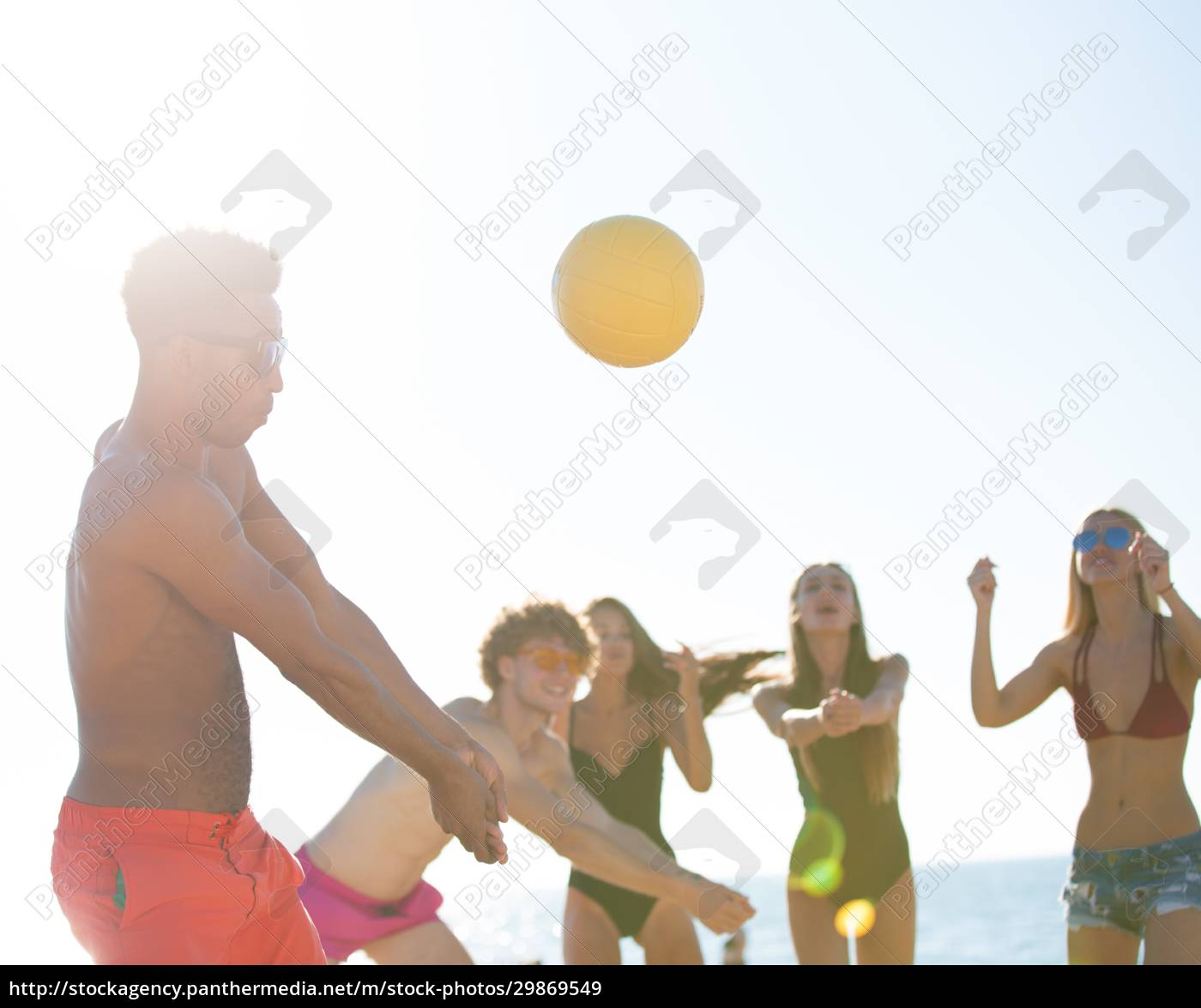 group, of, friends, playing, at, beach - 29869549
