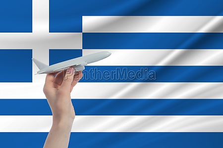 airplane, in, hand, with, national, flag - 30360042